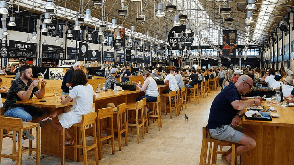 People eating and drinking at Time Out Market in lisbon.