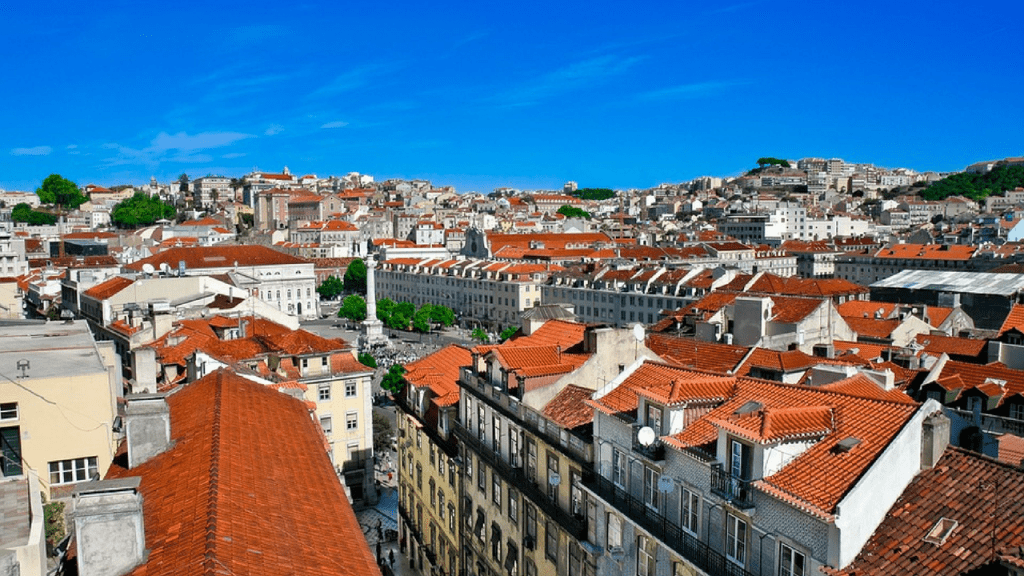 low rise lisbon neighborhood where you can see the blue sky above red tile roofs