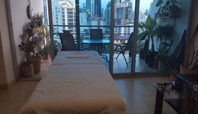 A massage table set up in a high rise apartment in Panama City